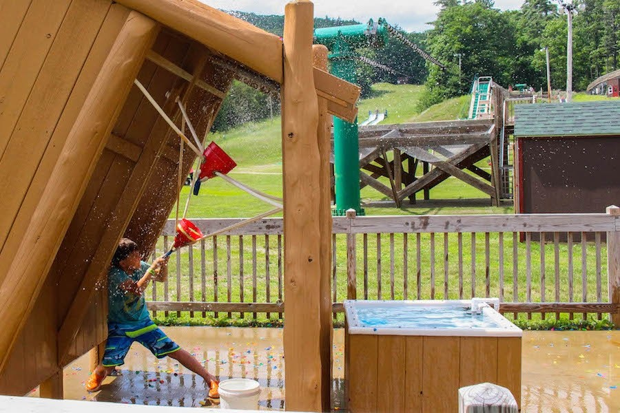 "Water Wars is an exciting game where up to four players hide out in ""dugouts"" armed with slingshots, which they fill with water balloons. (Gunstock)"