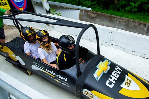 Go faster than you're allowed to drive a car through town on Whiteface's bobsled. (Whiteface)