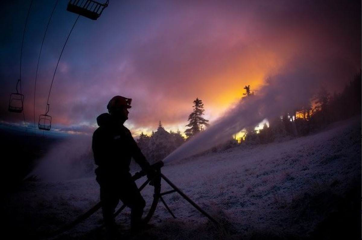 Just before dawn, snowmaking lights up the morning sky at Killington. (Killington Mountain Resort/Twitter)