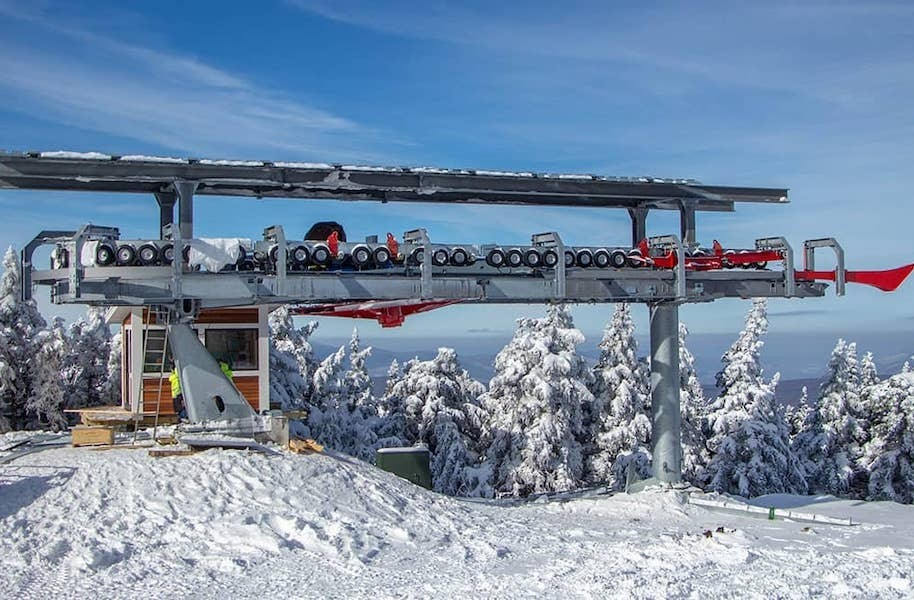 Work continues on the top terminal of the new Snow Bowl lift. (Stratton)