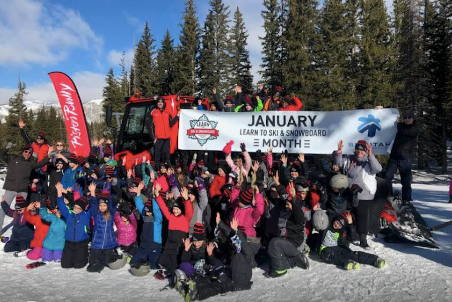 A big group in Utah gathers for a photo op at the first Learn to Ski or Snowboard Day Celebration. (LSSM/Facebook)